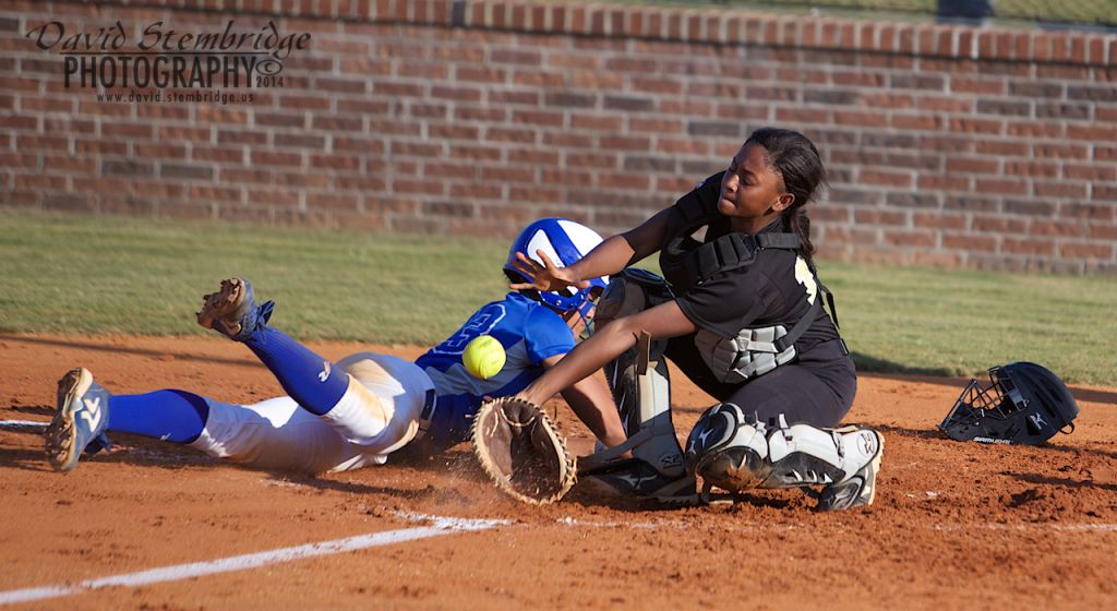 Amber Hills slides into homeplate to score against Thomson.