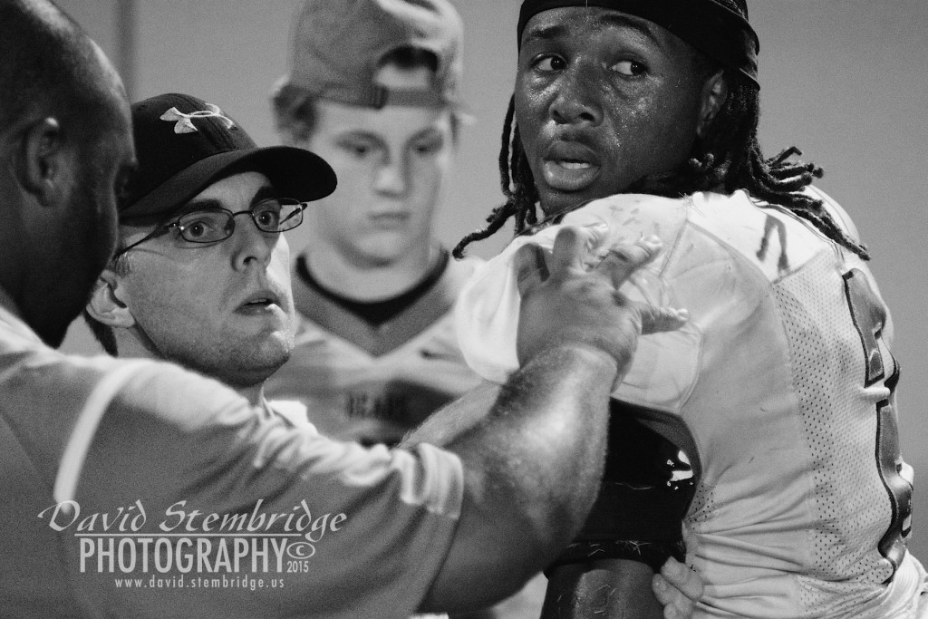 On the sidelines at a Burke County High School Football game, Caleeb Roberson gets looked at after sustaining an injury to his should.